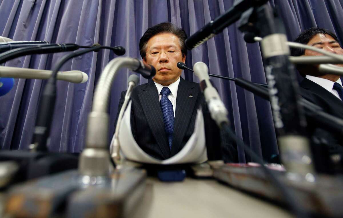 Mitsubishi Motors President Tetsuro Aikawa listens to a reporter's question during a press conference in Tokyo, Tuesday, April 26, 2016. Mitsubishi Motors, the Japanese automaker that acknowledged last week that it had intentionally lied about fuel economy data for some of its models, said an internal investigation found such tampering dated back to 1991. Aikawa told reporters Tuesday the probe was ongoing, suggesting that more irregularities might be found. (AP Photo/Shizuo Kambayashi)