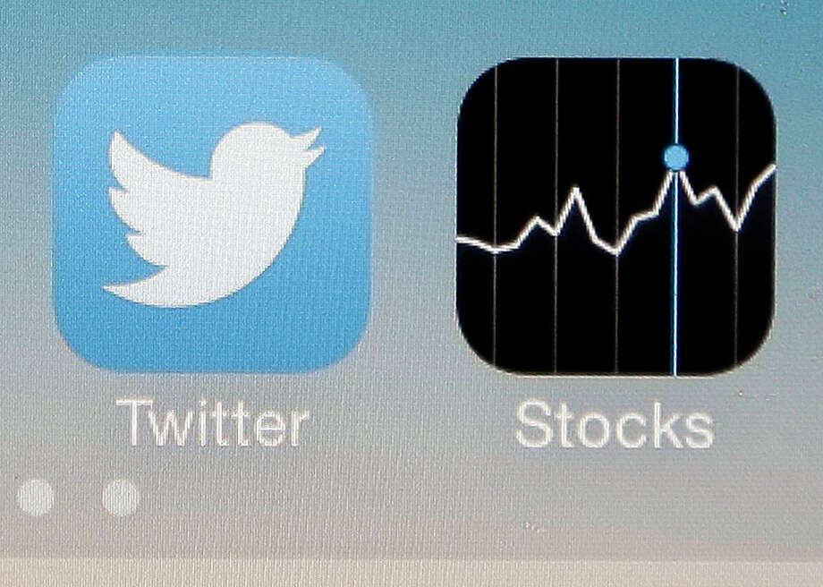 Twitter shares slid after its earnings report came out, though the social network showed modest growth in the number of active users. Photo: Marcio Jose Sanchez, STF / AP2013