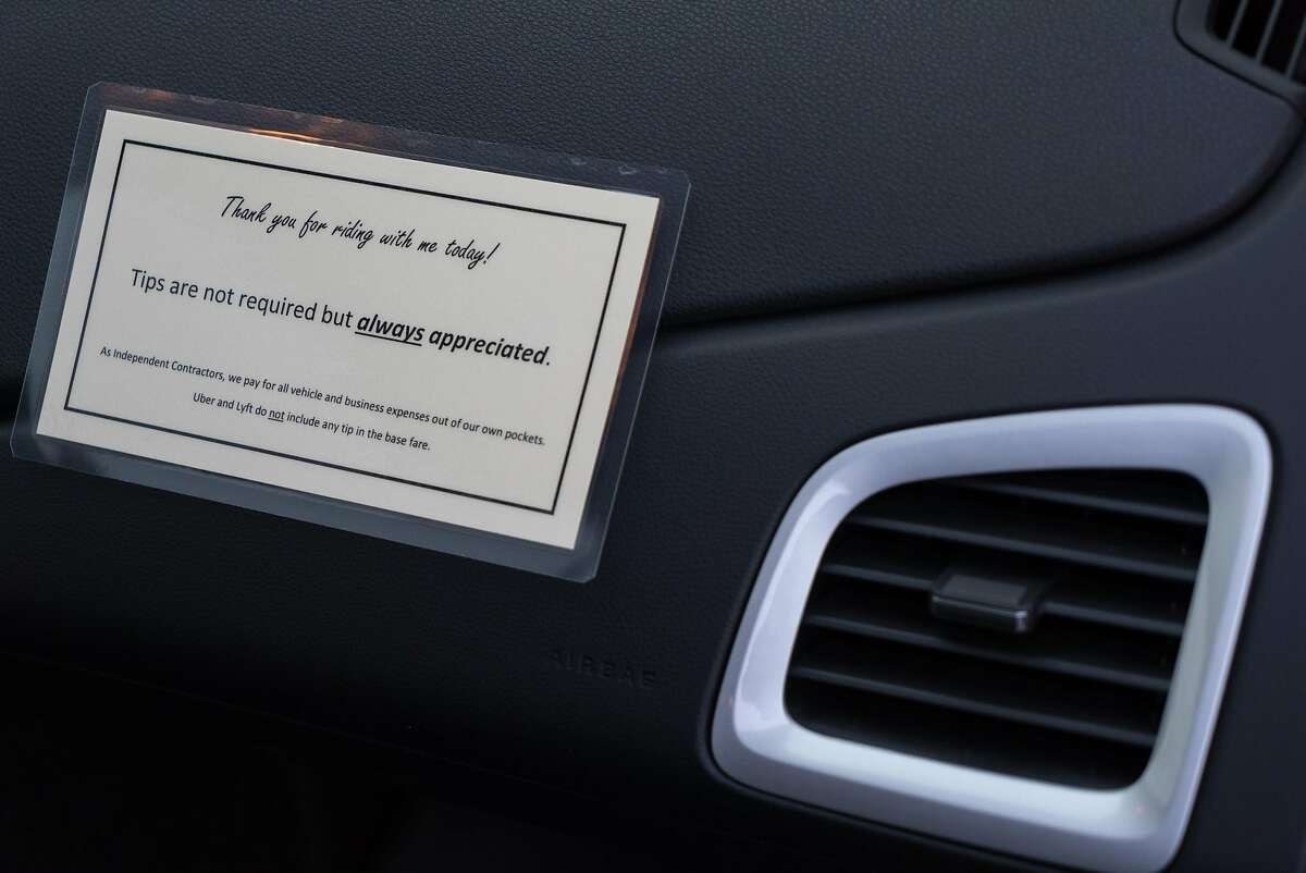 Signage in Mark Hall's car he drives for Uber informs passengers about tipping in San Jose, Calif. on Tuesday, April 26, 2016. Uber drivers can now inform passengers that tipping is allowed.