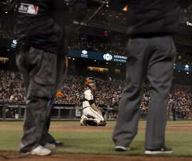 Buster Posey (28) waits for the call on an replay review on a double play in the fifth inning as the San Francisco Giants played the San Diego Padres at AT&T Park in San Francisco, Calif., on Tuesday, April 26, 2016.