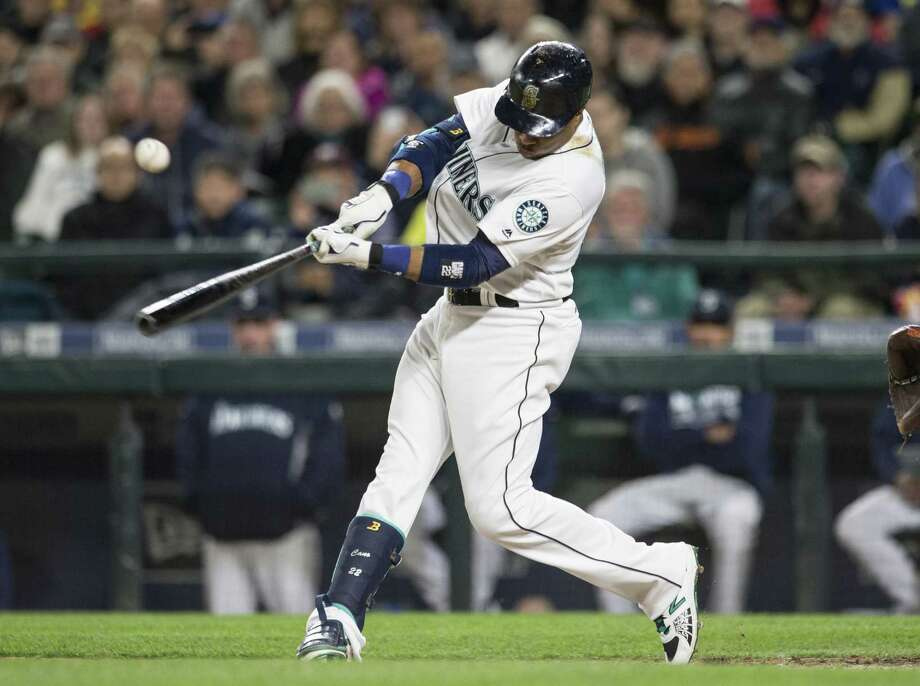 SEATTLE, WA - APRIL 26: Robinson Cano #22 of the Seattle Mariners hits a RBI single during the fifth inning of a game against the Houston Astros at Safeco Field on April 26, 2016 in Seattle, Washington. The RBI was 1,000th of Cano's career. Photo: Stephen Brashear, Getty Images / 2016 Getty Images