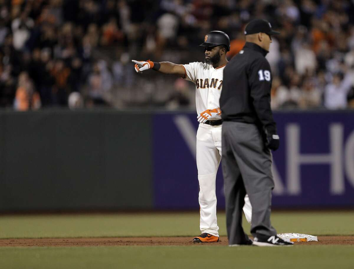 Denard Span (2) points back to the dugout after hitting a fifth inning rbi double that scored Brandon Crawford as the San Francisco Giants played the San Diego Padres at AT&T Park in San Francisco, Calif., on Tuesday, April 26, 2016.