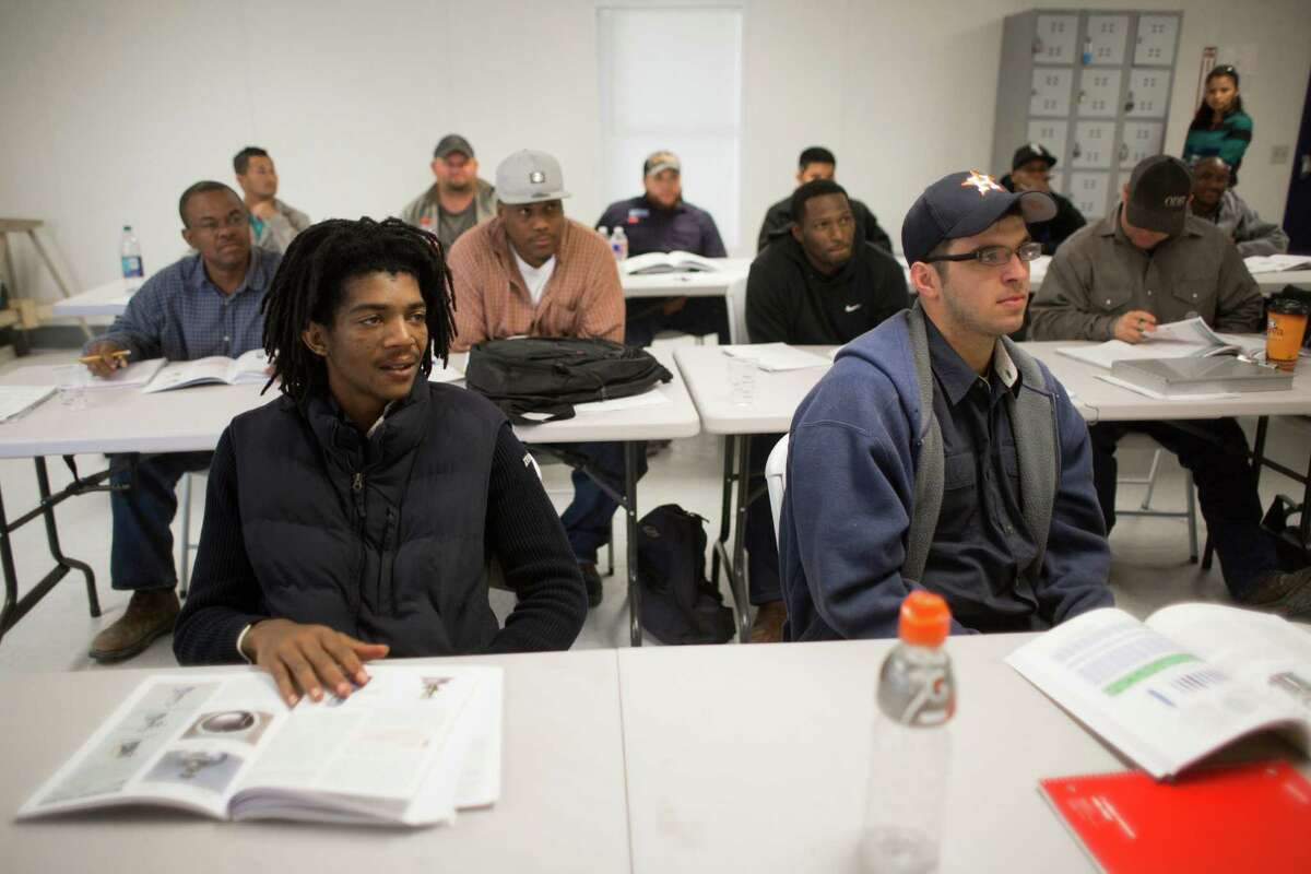 Jatony Dupre, left, and Jared Pitts, learn a new trade at the Fluor U.S Gulf Coast Craft training Center, Tuesday, April 26, 2016, in Pasadena.