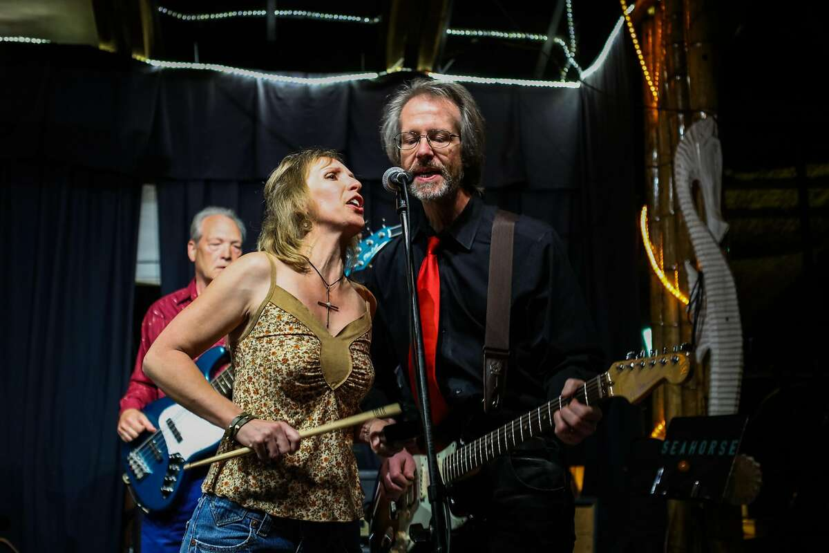 Laurie Cooper (left) and Ray Brindley (right) sing together as they perform with their band Firewheel at Sausalito Seahorse in Marin County, California, on Friday, April 22, 2016.