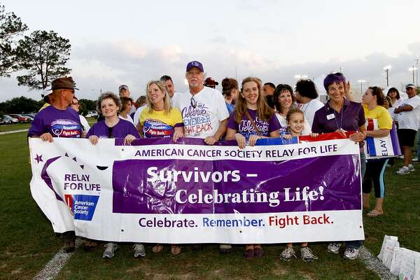 This weekend's Relay for Life in Katy will begin with cancer survivors walking the first lap. Above Cancer survivors line up at the starting line at an earlier American Cancer Society's Relay for Life in Katy.