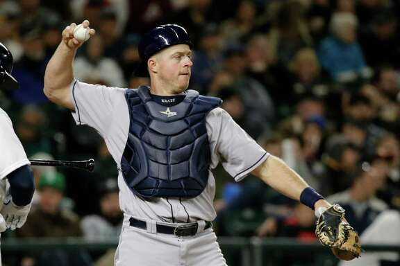 Houston Astros catcher Erik Kratz in action against the Seattle Mariners in a baseball game Monday, April 25, 2016, in Seattle. (AP Photo/Elaine Thompson)