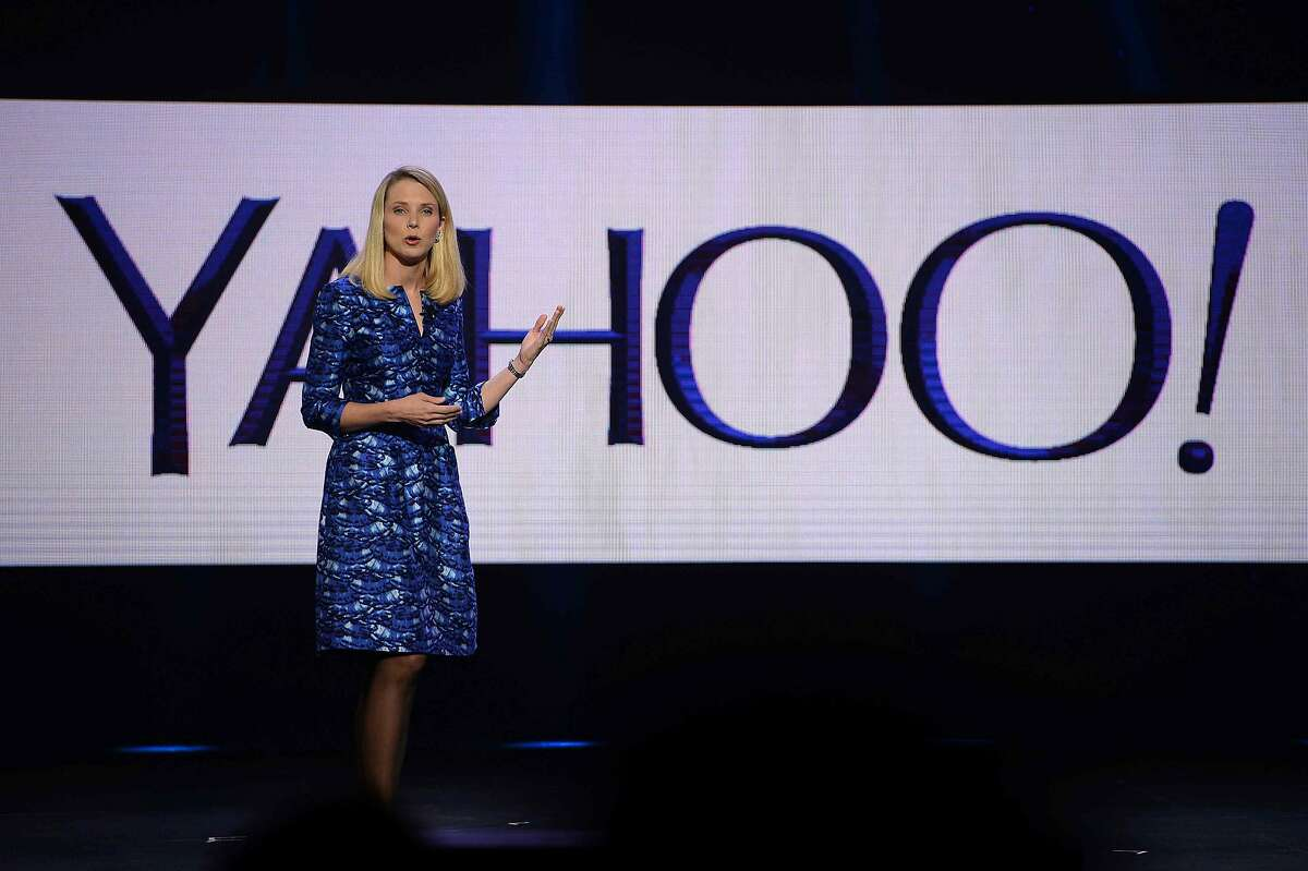 """(FILES) This file photo taken on January 7, 2014 shows Yahoo CEO Marissa Mayer speaks during her keynote address at the 2014 International CES in Las Vegas, Nevada. Yahoo struck a compromise April 26, 2016 with an activist investment fund seeking to take over the Internet group's board of directors, under which it will add four new board members. A Yahoo statement said four members will be added from the investment firm Starboard Value. """"This constructive resolution will allow management and the board to keep our focus on our extremely important objectives,"""" chief executive Marissa Mayer said. / AFP PHOTO / ROBYN BECKROBYN BECK/AFP/Getty Images"""