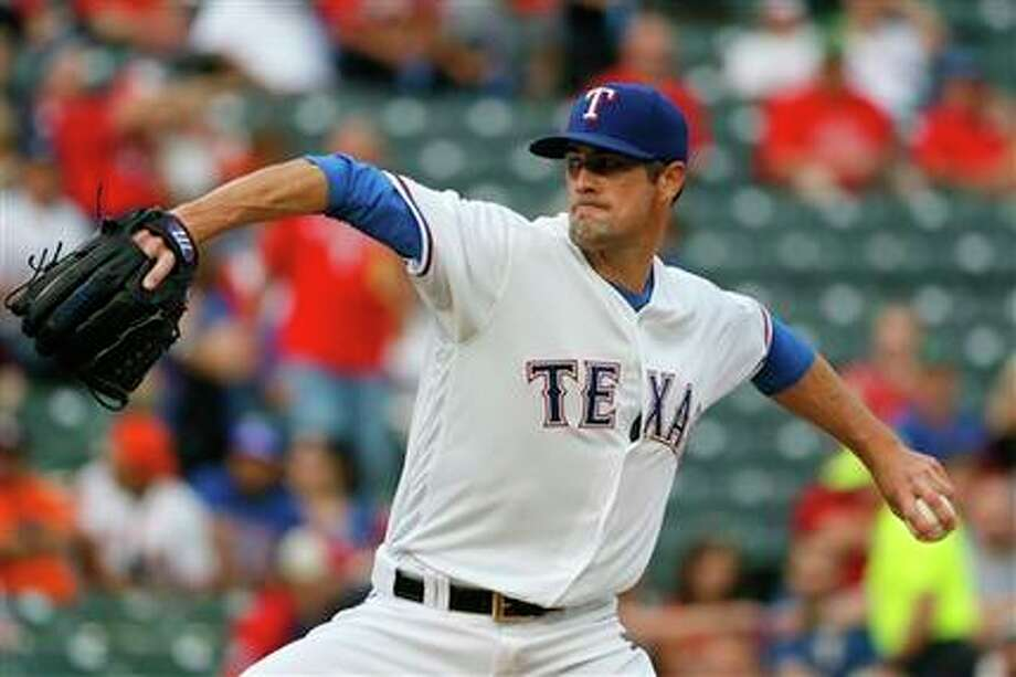 Cole Hamels, as well as Chris Sale recently, have bogged down the Astros in offensive inadequacy. Photo: Tony Gutierrez, AP