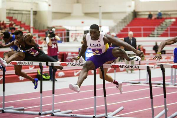 LSU's Jordan Moore clears a hurdle in the 60-meter hurdles final during the Southeastern Conference indoor track and field championships Saturday, Feb. 27, 2016, in Fayetteville, Ark.