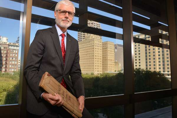 Philip Green is chairman and CEO of Cullen/Frost Bankers Inc., the parent company of Frost Bank. In this 2015 phtoo, he is holding one of the bank's original ledgers from bank founder Col. T.C. Frost.