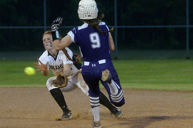 Port Neches-Groves' Rachel Hammersmith slides toward the bag as Nederland's Lindsey Taylor goes for the out at second during their district softball match-up Tuesday in Port Arthur. Photo taken Tuesday, April 26, 2016 Kim Brent/The Enterprise