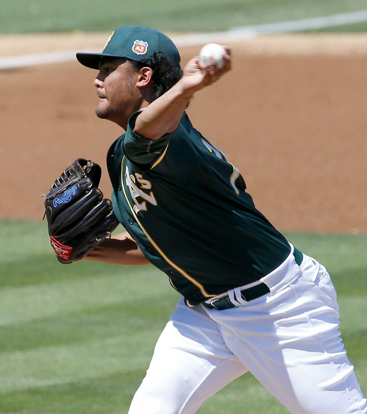 Oakland A's pitcher Sean Manaea throws against the Los Angeles Angels during the first inning of a spring training baseball game, Friday, March 25, 2016, in Mesa, Ariz. (AP Photo/Matt York)