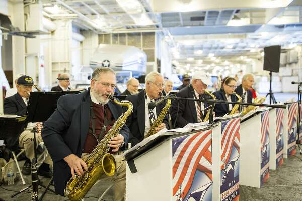 The USS Hornet Band performs for guests of the USS Hornet Museum in Alameda, Calif., on Saturday, April 16, 2016. The museum is located on a historic aircraft carrier.