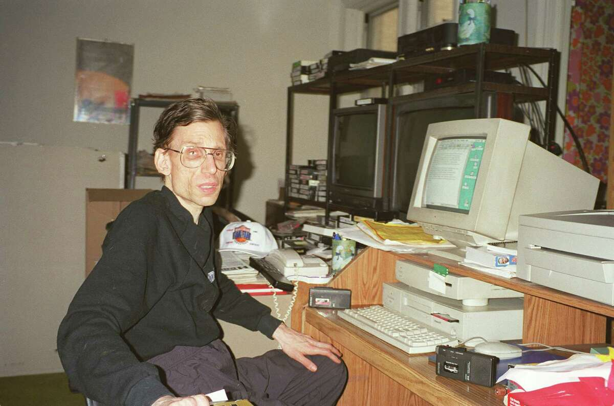 The late NFL draft analyst Joel Buchsbaum, pictured here in 1998 in his Brooklyn apartment, was a mythical figure for the listeners who heard him on Houston radio for decades. He died in 2002 at age 48.