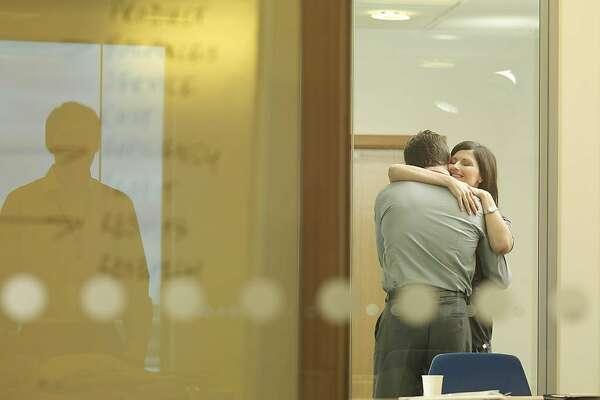Office couple cuddling