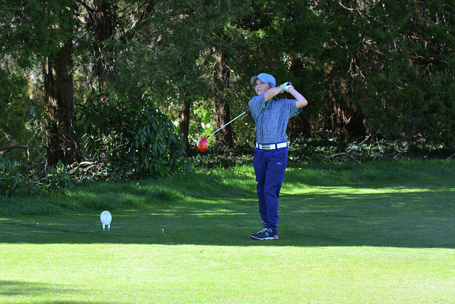 GFA seventh grader Will Lodge of Darien tees off against Masters School. Photo: Contributed / New Canaan News