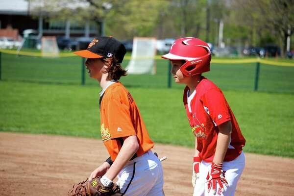 Orioles first baseman Trey Hartnett holds the Cardinals' Cooper Dinan on the bag.