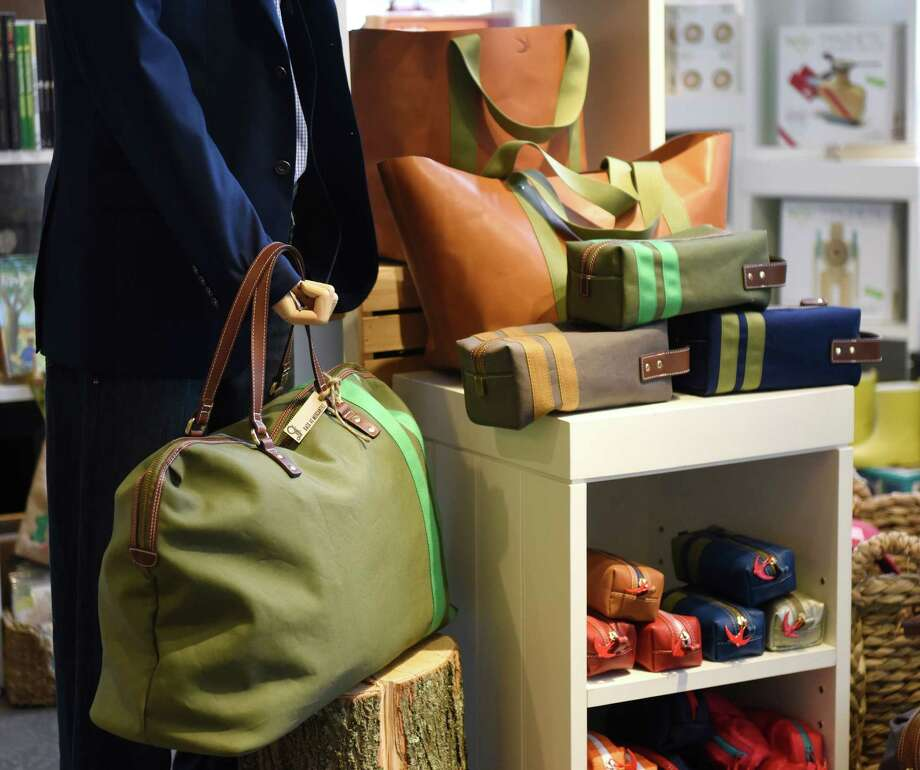 A collection of Corroon bags are displayed at Back 40 Mercantile in Old Greenwich, Conn. Tuesday, April 26, 2016. Photo: Tyler Sizemore / Hearst Connecticut Media / Greenwich Time