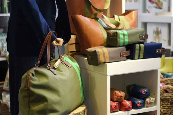 A collection of Corroon bags are displayed at Back 40 Mercantile in Old Greenwich, Conn. Tuesday, April 26, 2016.