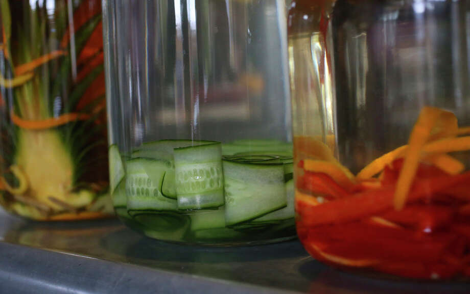From left: Piña (pineapple) Mezcal, Pepino Infusion (cucumber-infused vodka) and Fresno Gin (gin infused with Fresno chiles and orange peels) at The Frutería. Photo: John Davenport /San Antonio Express-News / ©San Antonio Express-News/John Davenport