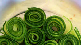 Rolled up cucumbers make an attractive presentation for infusing vodka at The Frutería.
