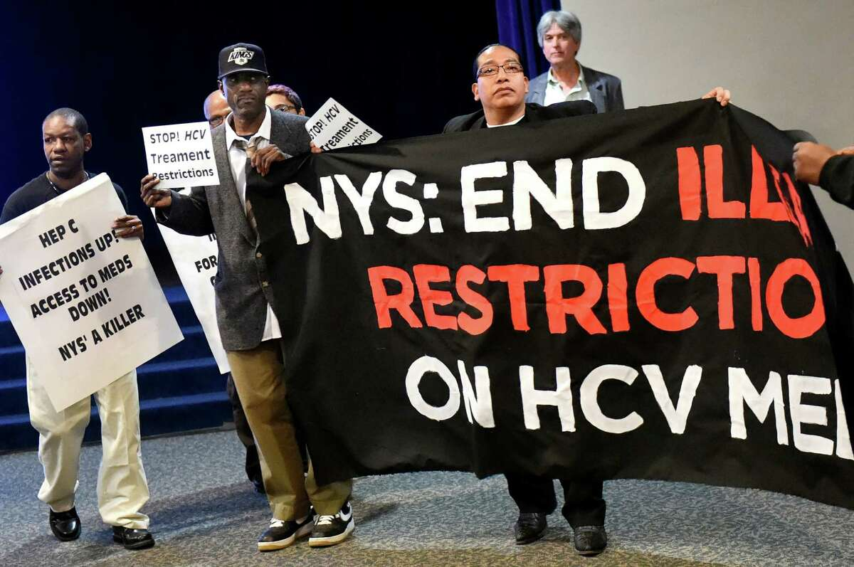 Members of Vocal NY disrupt the state Health Dept.'s Drug Utilization Review Board forum on Wednesday, April 27, 2016, at the Empire State Concourse in Albany, N.Y. Vocal NY demanded that those living with Hepatitis C have unrestricted access to the cure through Medicaid. (Cindy Schultz / Times Union)