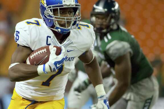 San Jose State running back Tyler Ervin (7) runs with the football while playing against Hawaii in the first quarter of an NCAA college football game, Saturday, Nov. 21, 2015, in Honolulu. (AP Photo/Eugene Tanner)