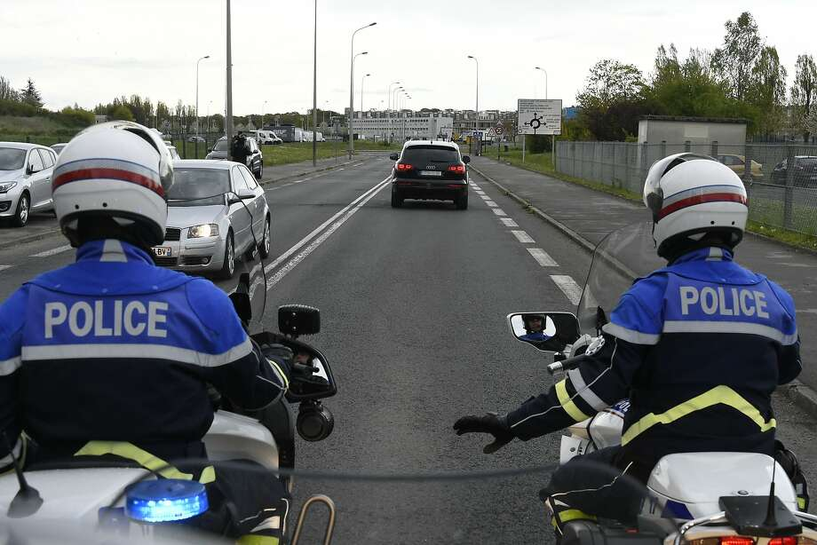 Police escort a convoy carrying Salah Abdeslam to a prison near Paris after his extradition from Belgium. Photo: DOMINIQUE FAGET, AFP/Getty Images