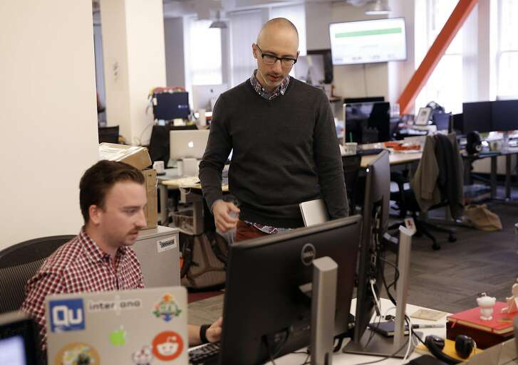 Kavin Stewart , (right) the new vice president of product, revenue and growth at Reddit, talks with Justin Bassett, a data scientist, at their company headquarters in downtown San Francisco, California on Wed. April 27, 2016.