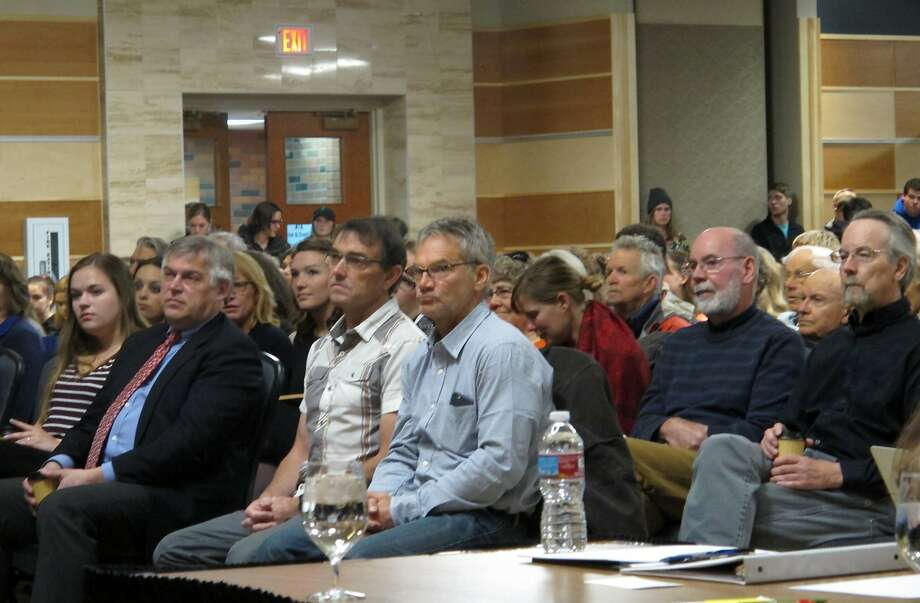 Author Jon Krakauer (center in blue shirt) listens to court proceedings in Bozeman. Krakauer wants to know why the University of Montana reversed a decision to expel a star quarterback accused of rape. Photo: Matt Volz, Associated Press