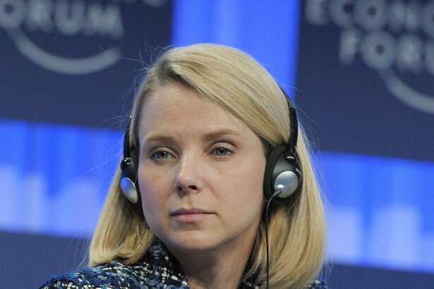 "(FILES) This file photo taken on January 25, 2014 shows Yahoo CEO Marissa Mayer, Co-Chair of the World Economic Forum Annual Meeting 2014, as she attends a session in Davos. Yahoo on April 19, 2016 reported a quarterly loss as the struggling Internet pioneer continued to court potential buyers and examine other strategic options. Yahoo chief executive Marissa Mayer said the company has ""made substantial progress towards potential strategic alternatives"" while working to trim costs and drive growth.  / AFP PHOTO / ERIC PIERMONTERIC PIERMONT/AFP/Getty Images"