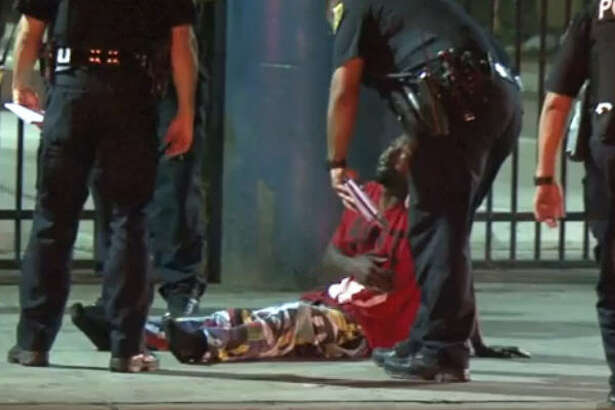 A man is in custody after he rammed into a car during a brief police chase early Wednesday morning downtown.  after he sped away from a traffic stop in downtown.  About 12:10 a.m., a Houston police officer said he saw a car run a red light and almost hit his squad car on Main near Polk, said Lt. Larry Crowson of the Houston Police Department.  The officer stopped the driver, who appeared to be impaired, Crowson said. When the officer asked the driver to step out of his car, he sped away with the officer in pursuit.  Just seven blocks south, the man ran a red light and crashed into another car at Main and Pierce, where he was taken into custody.  The passenger in car that was hit was taken to a nearby hospital as a precaution.  He is expected be fine.  No other injuries were reported.  Crowson said the driver who fled police may be charged with evading. He could also face additional charges if he is determined to have been intoxicated or impaired.