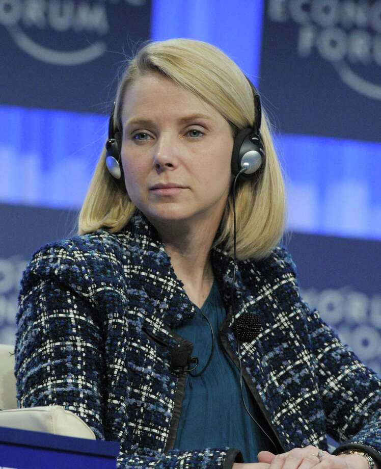 """Yahoo CEO Marissa Mayer, Co-Chair of the World Economic Forum Annual Meeting 2014, as she attends a session in Davos. Yahoo on April 19, 2016 reported a quarterly loss as the struggling Internet pioneer continued to court potential buyers and examine other strategic options. Yahoo chief executive Marissa Mayer said the company has """"made substantial progress towards potential strategic alternatives"""" while working to trim costs and drive growth. Photo: ERIC PIERMONT /AFP /Getty Images / AFP or licensors"""
