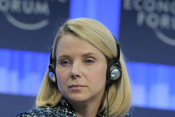 """Yahoo CEO Marissa Mayer, Co-Chair of the World Economic Forum Annual Meeting 2014, as she attends a session in Davos. Yahoo on April 19, 2016 reported a quarterly loss as the struggling Internet pioneer continued to court potential buyers and examine other strategic options. Yahoo chief executive Marissa Mayer said the company has """"made substantial progress towards potential strategic alternatives"""" while working to trim costs and drive growth."""