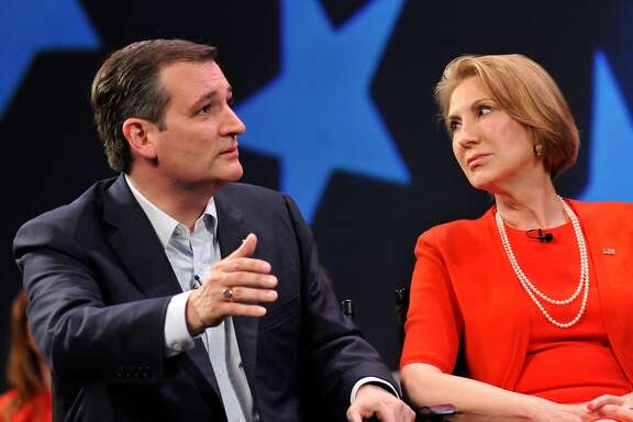 MARCH 11: Republican presidential candidate Sen. Ted Cruz (R-TX) and former candidate Carly Fiorina (L) in a discussion with political commentator Sean Hannity during a campaign rally at Faith Assembly of God Church on March 11, 2016 in Orlando, Florida. The candidates continue to campaign before the March 15th Florida primary. (Photo by Gerardo Mora/Getty Images)