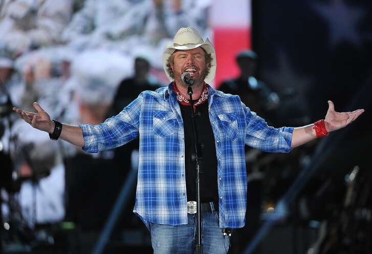 FILE - In this April 7, 2014, file photo shows Toby Keith performs at ACM Presents an All-Star Salute to the Troops  in Las Vegas.  Keith will perform a tribute to the late legend Merle Haggard during the American Country Countdown Awards on May 1, 2016. (Photo by Chris Pizzello/Invision/AP, File)