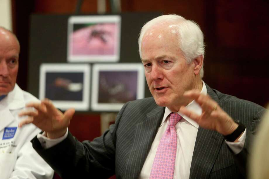 Sen. John Cornyn , in Houston recently to gather information about the Zika virus from doctors and Harris County Public Health & Environmental Services, is one of the main authors of a sentencing reform bill. Photo: Gary Coronado /Houston Chronicle / © 2015 Houston Chronicle