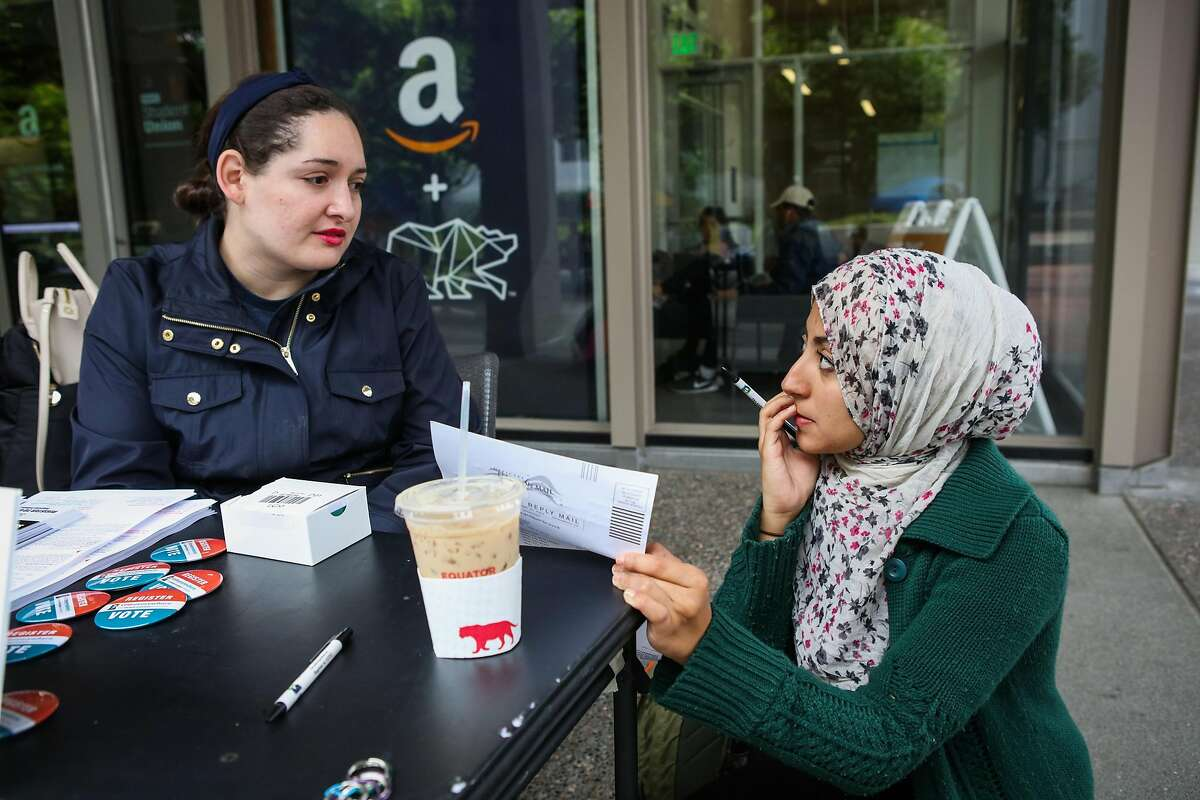 Hanin Benchohra, 21, (right) gets help from student Sarah Funes, 24 as she fills out a voter registration form, at UC Berkeley, in Berkeley, California, on Wednesday, April 27, 2016. Hanin is voting for the first time in her life.