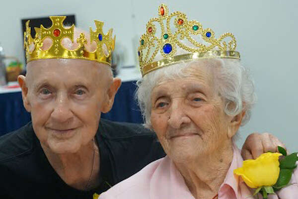 """Alfred Fox, 96, and Dorothea Cosentino, 99, celebrate being crowned king and queen of the recent """"Celebrating 90-Plus years Young"""" birthday celebration for New Milford residents."""