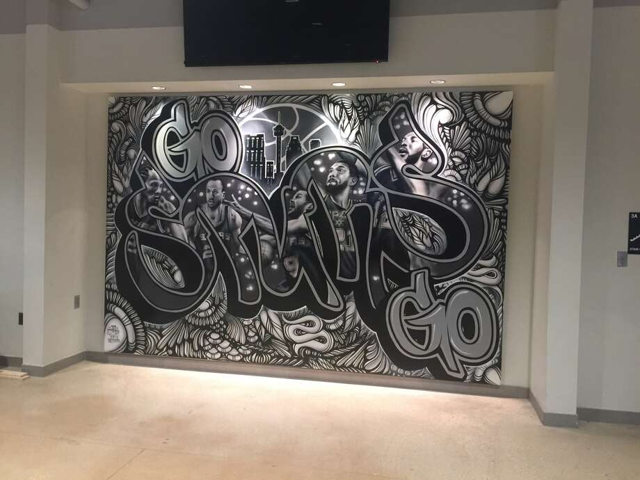 "The first installation of the Spurs' ""Paint the Town Silver and Black"" initiative debuted at the AT&T Center during the first round of playoffs. Photo: Provided By Spurs Sports And Entertainment"