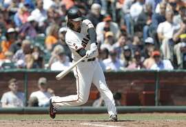 Giants' pitcher Jeff Samardzija hits a single to drive in two runs with the bases loaded in the 3rd inning as the San Francisco Giants take on the San Diego Padres at AT&T Park in San Francisco, California on Wed. April 27, 2016.