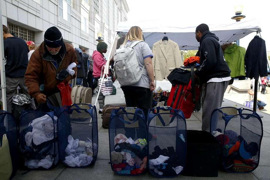 A Pop-Up Care Village outside San Francisco's Main Library offers donated clothing and other items for the homeless. Photo: Connor Radnovich, The Chronicle