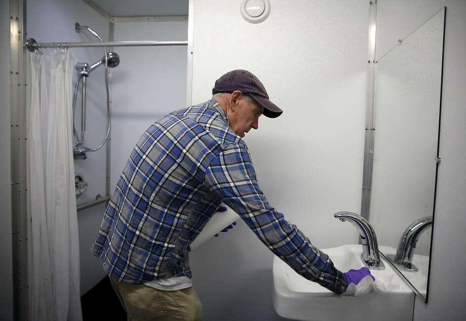 Check the bath and do a quick wipe down Photo: Connor Radnovich, The Chronicle