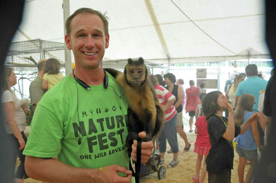 "Bridgeland will host its ninth annual Nature Fest April 30. Above, Brian Staples and ""€œWilson""€ the Capuchin monkey participated in an earlier Nature Fest at Bridgeland'€™s Oak Meadow Park. Photo:  Tony Bullard 2014, Freelance Photographer / © Tony Bullard & the Houston Chronicle"