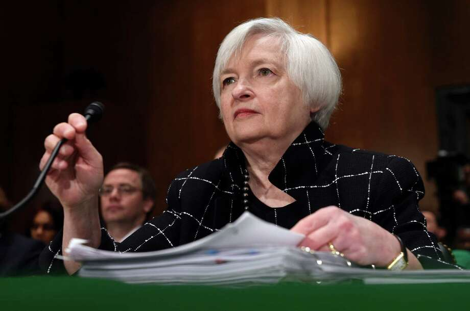 """FILE - In this Thursday, Feb. 11, 2016, file photo, Federal Reserve Board Chair Janet Yellen prepares to testify on Capitol Hill in Washington, before the Senate Banking Committee hearing on: """"The Semiannual Monetary Policy Report to the Congress."""" On Wednesday, April 27, 2016, the Federal Reserve releases its latest monetary policy statement after wrapping up a two-day meeting. (AP Photo/Susan Walsh, File) ORG XMIT: NYBZ312 Photo: Susan Walsh / Copyright 2016 The Associated Press. All rights reserved. This m"""