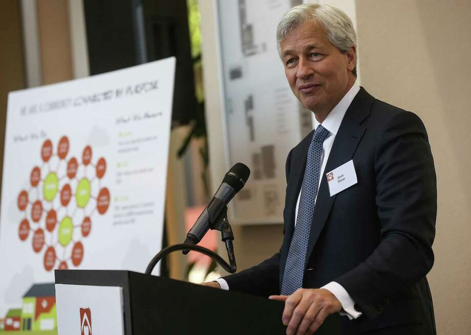 Jamie Dimon, chairman, president and chief executive officer of JPMorgan Chase addresses attendees of an announcement of a partnership to tackle the middle-skills jobs gap and move 1,000 underemployed individuals from low-wage jobs to living-wage, middle-skills jobs on Wednesday, April 27, 2016, in Houston. ( Elizabeth Conley / Houston Chronicle ) Photo: Elizabeth Conley, Staff / © 2016 Houston Chronicle