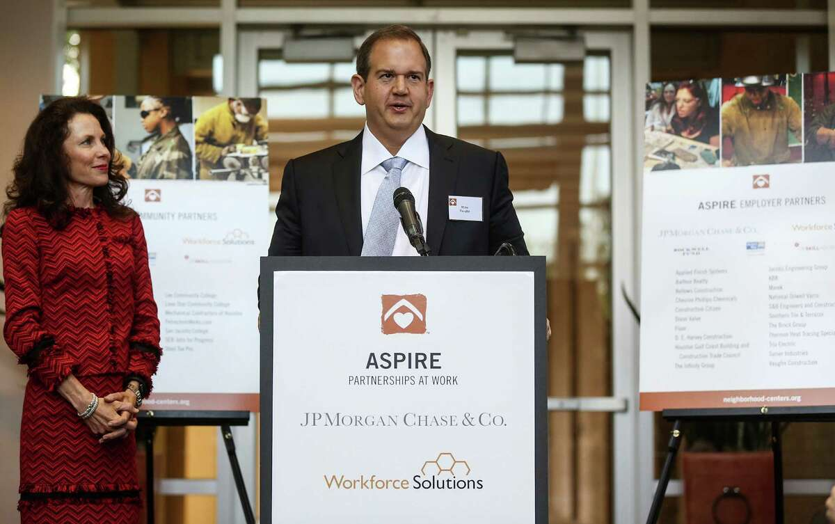 Michael Vaughn of Vaughn Construction, addresses attendees about the announcement of a partnership as Gina Luna, Houston-based managing director for JPMorgan Chase, looks on Wednesday, April 27, 2016, in Houston. ( Elizabeth Conley / Houston Chronicle )