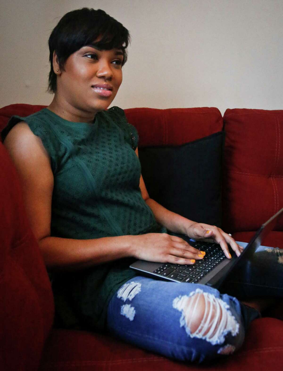 Jay Blessed, who previously broadcasted her own online radio show and listened to various unlicensed stations when she moved from Trinidad to Brooklyn more than a decade ago, prepare to update her blog which will interface her new podcast program, Sunday, April 24, 2016, in New York. Federal lawmakers and broadcasters are increasingly worried about pirate radio's presence in some cities as unlicensed broadcasters commandeer frequencies to play anything. (AP Photo/Bebeto Matthews)