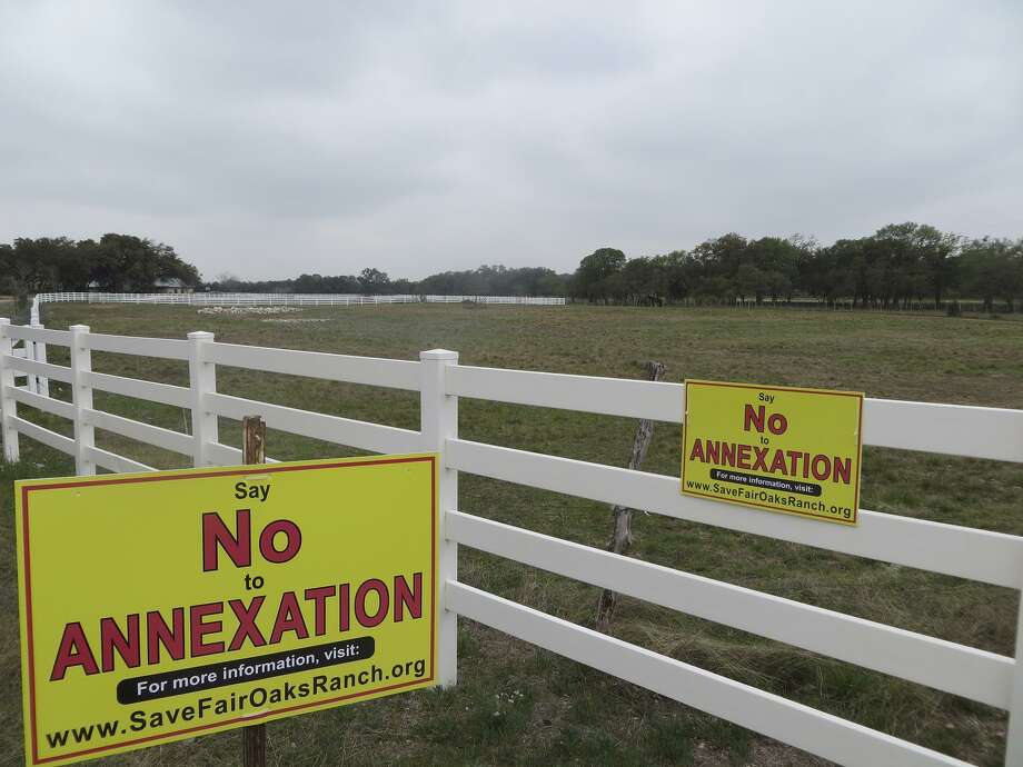 FILE PHOTO — Signs opposing the annexation of 345 acres along Ammann Road in Kendall County began appearing in Fair Oaks Ranch shortly before the City Council voted on an annexation petition April 17. Last month, Fair Oaks Ranch filed a law suit in state district court in Bexar County claiming violations of a development agreement. The suit is the latest volley between the city, the landowner and the would-be developer of The Reserve at Fair Oaks Ranch, a proposed 635-home subdivision that's been in limbo since last summer. Photo: Zeke MacCormack /San Antonio Express-News / San Antonio Express-News
