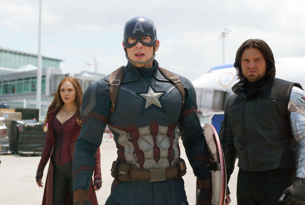 """This image released by Disney shows Elizabeth Olsen, left, Chris Evans and Sebastian Stan in a scene from Marvel's """"Captain America: Civil War,"""" opening in theaters nationwide on May 6, 2016. (Disney/Marvel via AP)"""